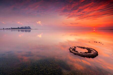 Dramatic sunrise over sea, Kelantan, Malaysia LANG_EVOIMAGES