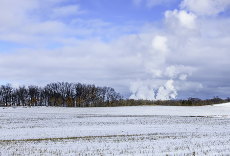 Steam from nuclear power plant seen across field, Illinois, America, USA LANG_EVOIMAGES