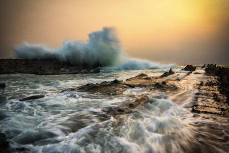 Wave crashing against rocks, Sawarna, Indonesia
