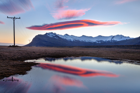 lenticular: Lenticular cloud over mountains, Iceland