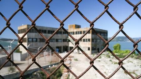 alcatraz: Alcatraz prison seen through chainlink fence, San Francisco, California, America, USA LANG_EVOIMAGES