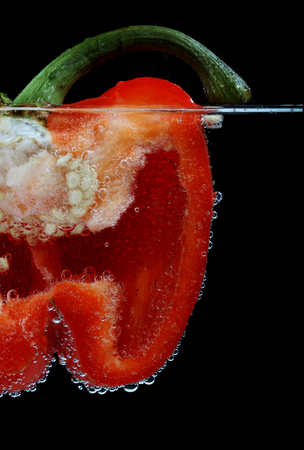 Close-up of halved red bell pepper in water LANG_EVOIMAGES