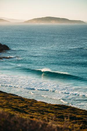 Wave breaking along coastline, Australia