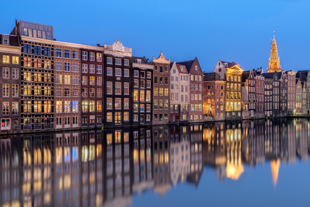 Row of houses along canal at dusk, Amsterdam, Holland