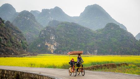 Mother and daughter cycling, Yunnan, China
