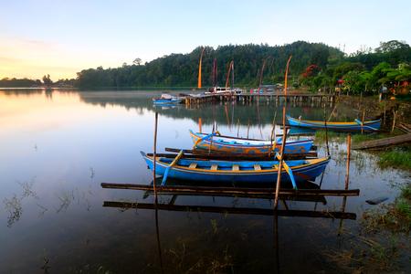 Fishing Boats anchored at Pura Ulun Danu, Bali, Indonesia  LANG_EVOIMAGES