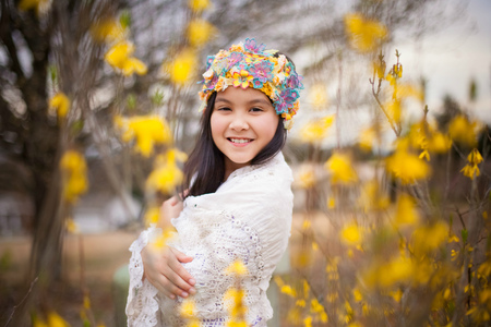 Portrait of a smiling girl standing amongst flowers, Tennessee, America, USA LANG_EVOIMAGES