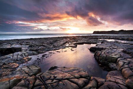 Coastal landscape ledges at sunset, Kimmeridge, Dorset, England, UK