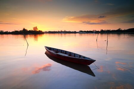 Boat anchored on the beach at sunset, Tuaran, Sabah, Malaysia