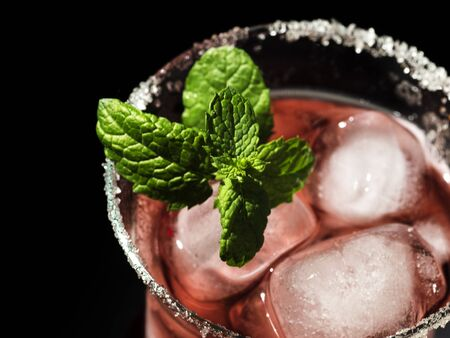 overhead view of Fruit juice cocktail with mint and salt