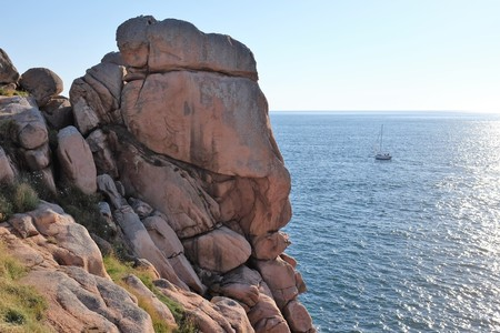 ploumanach: Boat sailing by Pink Granite Coast, Ploumanach, Brittany, France LANG_EVOIMAGES