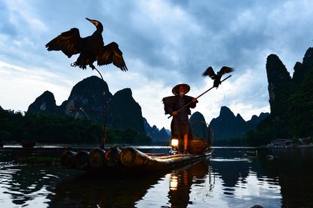 Silhouette of a  cormorant fisherman, Yangshuo, Guilin, China