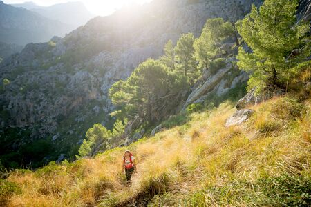 A young woman hiking in the backcountry of the Spanish island Mallorca