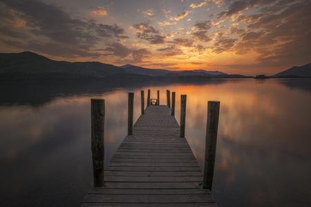 Jetty at Derwentwater at sunset, Lake District, Cumbria, England, UK