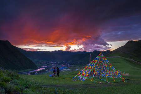 Man and woman photographing mountains, Kangding City, Tibet, China