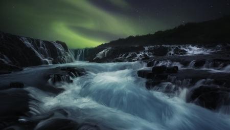 atmospheric phenomena: Northern lights over Bruarfoss Waterfall, Iceland