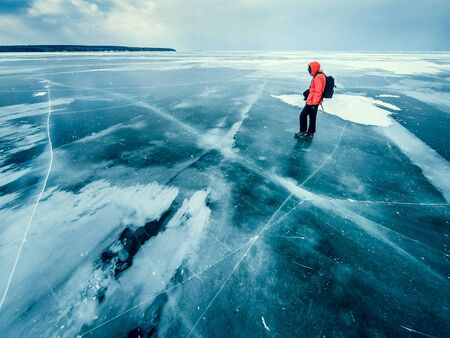one mature man only: Man standing on frozen lake, Apostle Islands, Wisconsin, America, USA