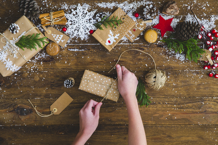 personal perspective: Girls hands wrapping a christmas gift