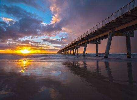 vanishing point: Pier reflection on beach at sunrise, Gold Coast, Queensland, Australia