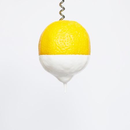 Lemon dipped in cream on a corkscrew LANG_EVOIMAGES