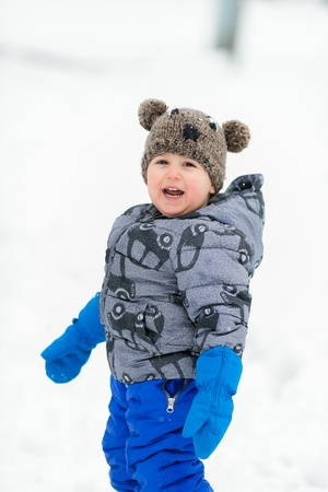 Boy in warm clothing in the snow