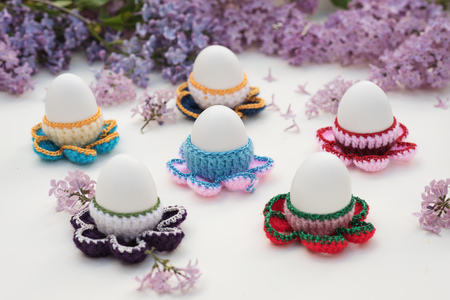 boiled eggs in crocheted egg cups with lilac flowers