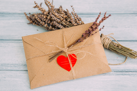 tied in: Envelope with heart sticker and dried flowers