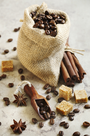 Bag with Roasted coffee beans, brown sugar, cinnamon sticks and star anise