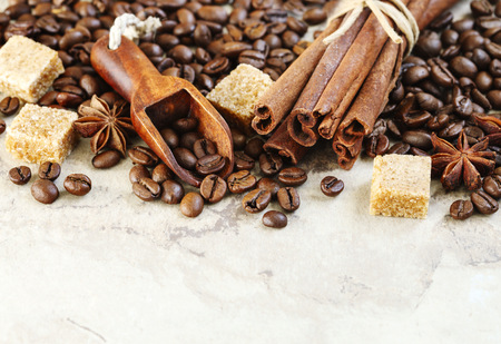 Roasted coffee beans, brown sugar, cinnamon sticks and star anise
