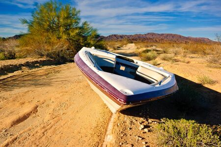 Boat abandoned on a road near Salome, Arizona, America, USA LANG_EVOIMAGES