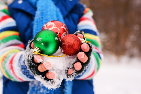 cupped: Close-up of Boy holding Christmas decorations LANG_EVOIMAGES