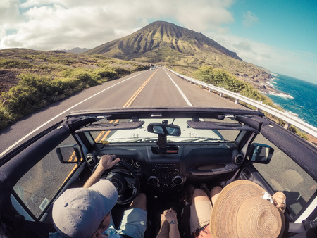 drivers seat: Rear view of a couple driving in a convertible, Lahaina, Maui, Hawaii, America, USA LANG_EVOIMAGES