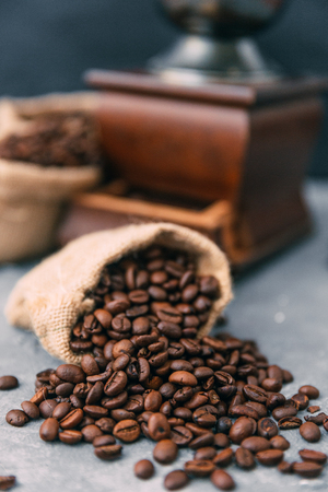 Close-up of coffee grinder and sacks of coffee beans LANG_EVOIMAGES