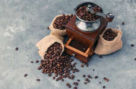 Coffee grinder with sacks of coffee beans LANG_EVOIMAGES