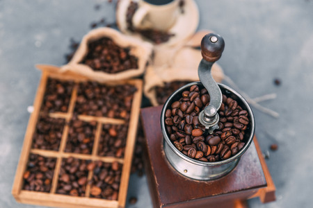 Close-up of coffee grinder and box of coffee beans