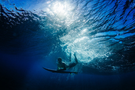 Man Duck Diving under a wave, Hawaii, America, USA LANG_EVOIMAGES