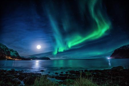 atmospheric phenomena: Northern lights and full moon, Vareidet, Flakstad, Lofoten, Nordland, Norway