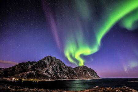 atmospheric phenomena: Aurora Borealis above Mt Nappstinden, Lofoten, Nordland, Norway