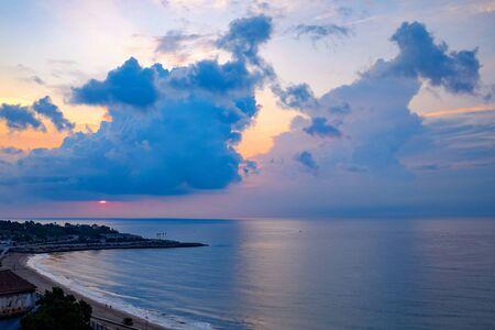 Sunset over beach,Tarragona,Catalonia,Spain LANG_EVOIMAGES