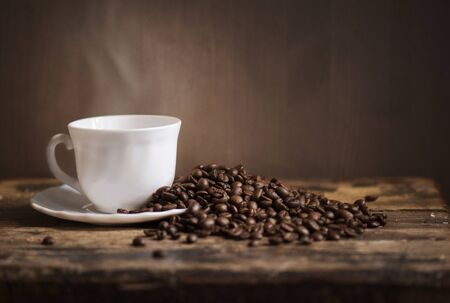 Cup of coffee and coffee beans LANG_EVOIMAGES