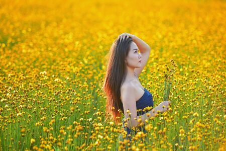 Beautiful woman picking flowers,Thailand