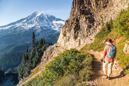 Woman hiking along an alpine trail, Mt Rainier, Washington, America, USA LANG_EVOIMAGES