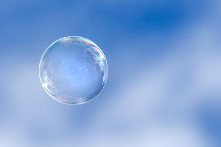 Soap bubble floating in a blue sky