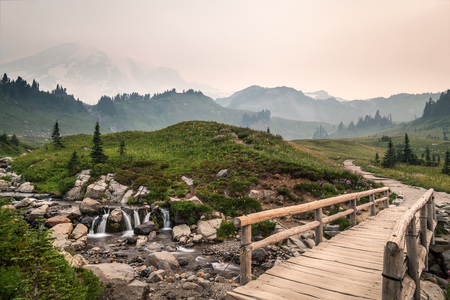 Hiking path at Mt. Rainier National Park with wildfires nearby, Washington, America, USA