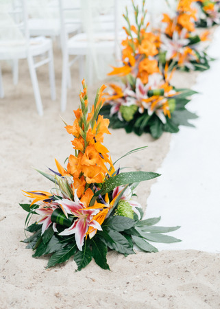 Floral arrangements at  a wedding on the beach LANG_EVOIMAGES