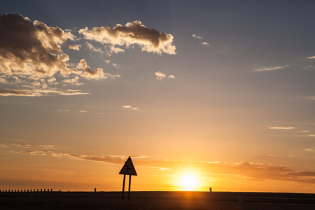 Silhouette of a road sign at Sunset, Swakopmund, Namibia LANG_EVOIMAGES