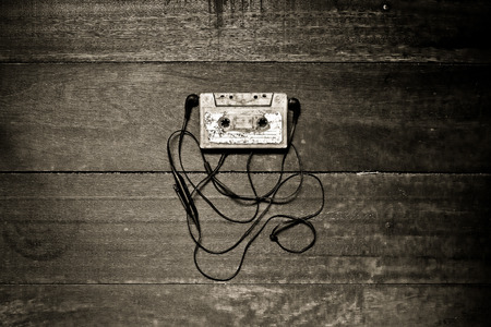 cassettes: old cassettes tape with Earphone on wooden background Stock Photo