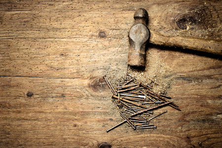 nails: hammer and nails on wooden work table Stock Photo