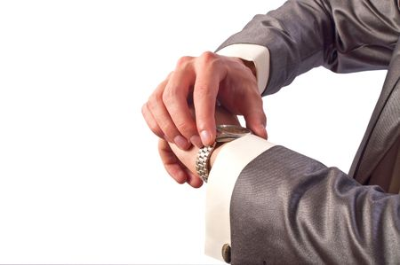 hands  hour: Mans hand in the suit pointing on his watch Stock Photo