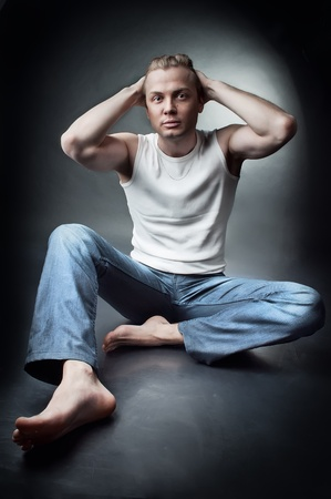 Studio portrait of sexy young guy wearing in jeans  photo